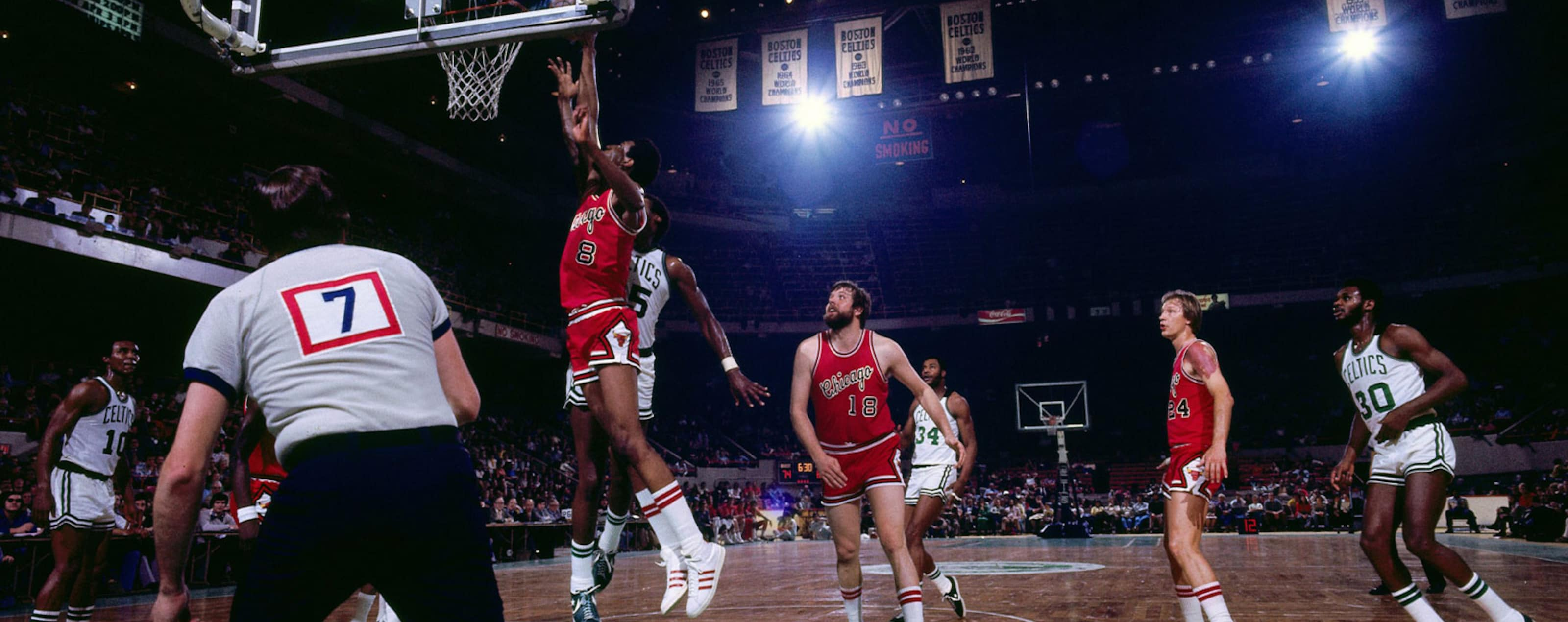 BOSTON - 1975: Mickey Johnson #8 of the Chicago Bulls shoots a layup against the Boston Celtics during a game played in 1975 at the Boston Garden in Boston, Massachusetts.
