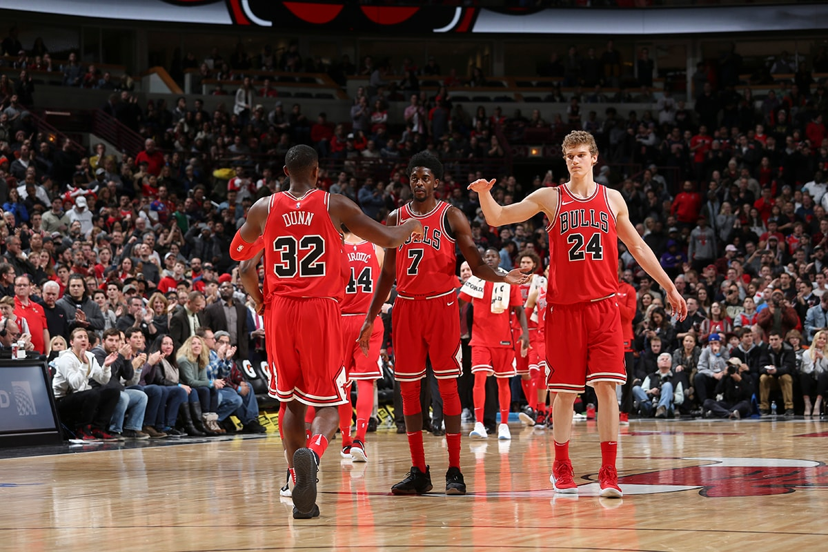 Kris Dunn #32, Justin Holiday #7 and Lauri Markkanen #24 of the Chicago Bulls react during game against the New York Knicks on December 27, 2017 at the United Center in Chicago, Illinois.