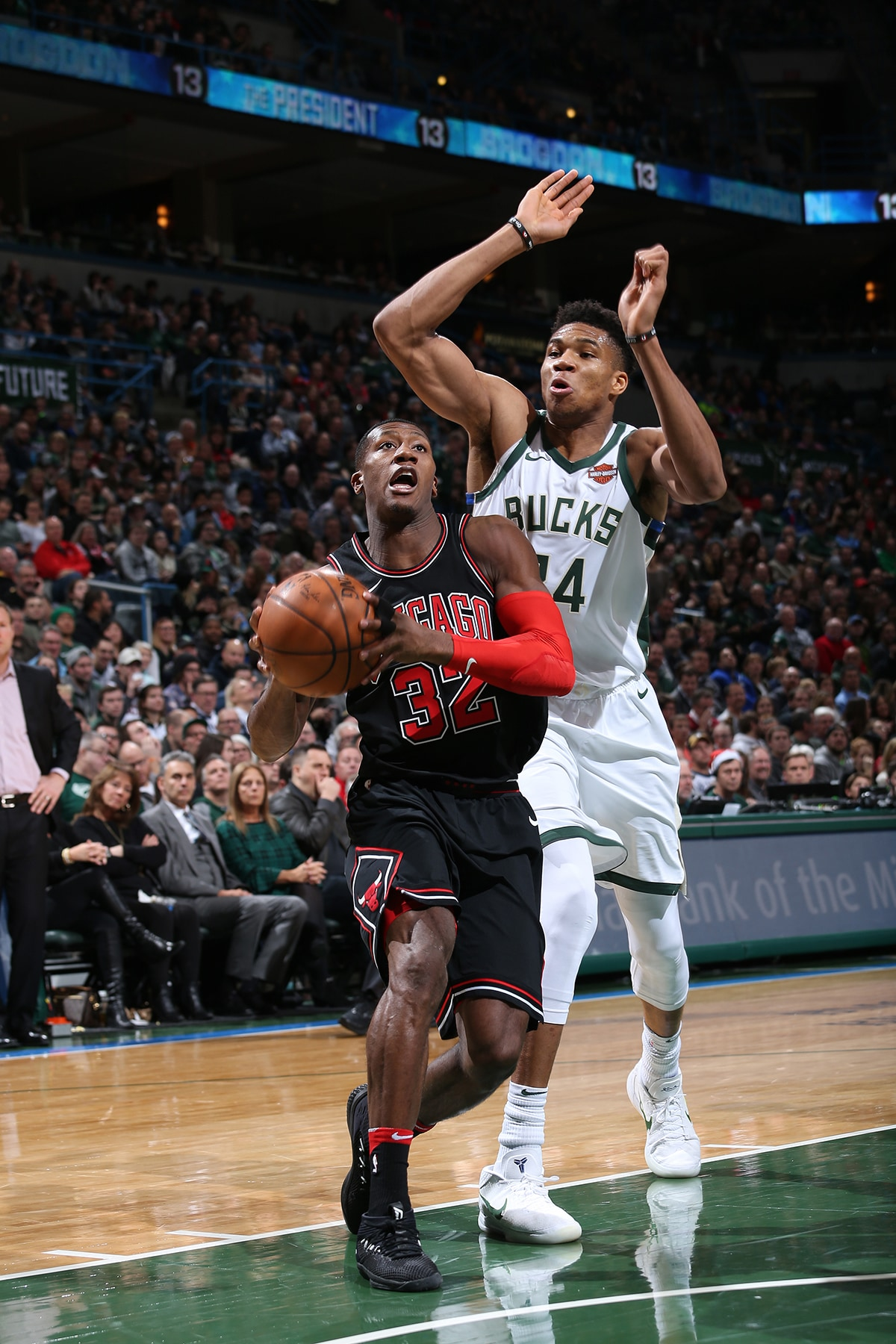 Kris Dunn #32 of the Chicago Bulls handles the ball against Giannis Antetokounmpo #34 of the Milwaukee Bucks on December 26, 2017 at the BMO Harris Bradley Center in Milwaukee, Wisconsin