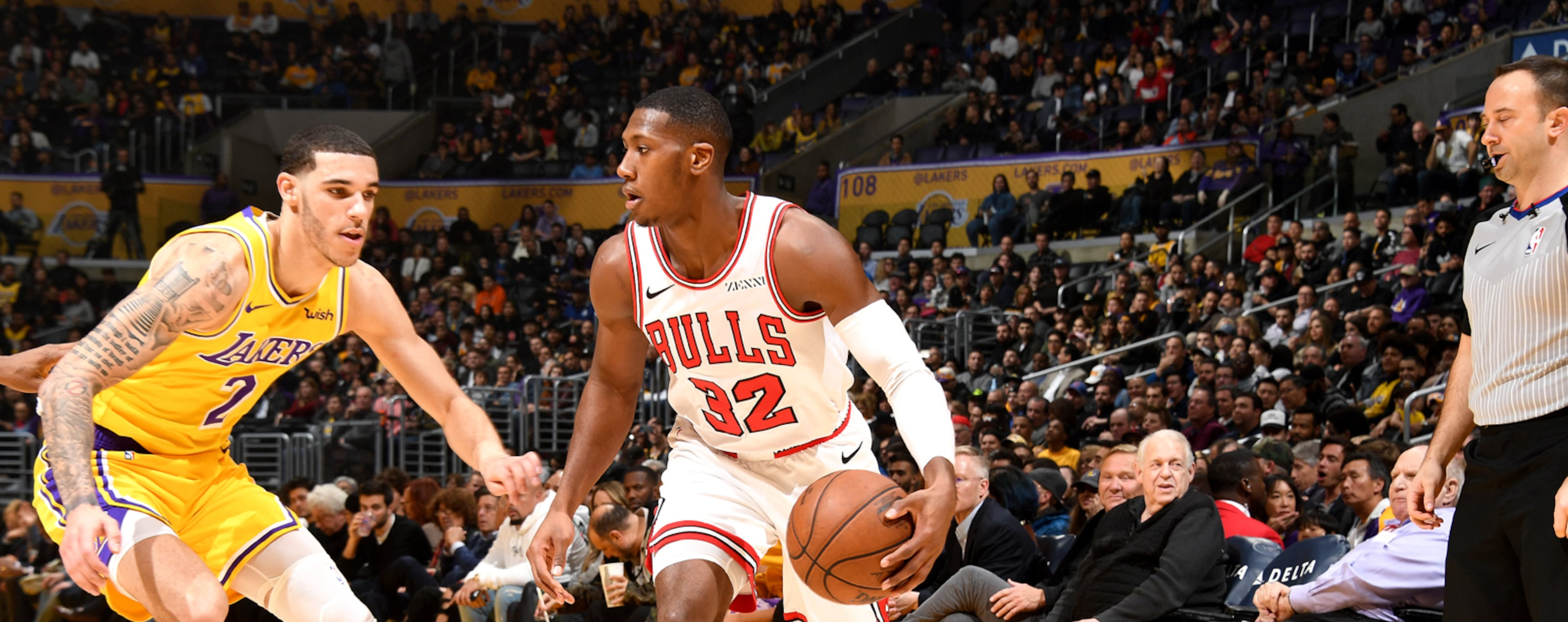 Kris Dunn dribbling during Los Angeles Lakers game.