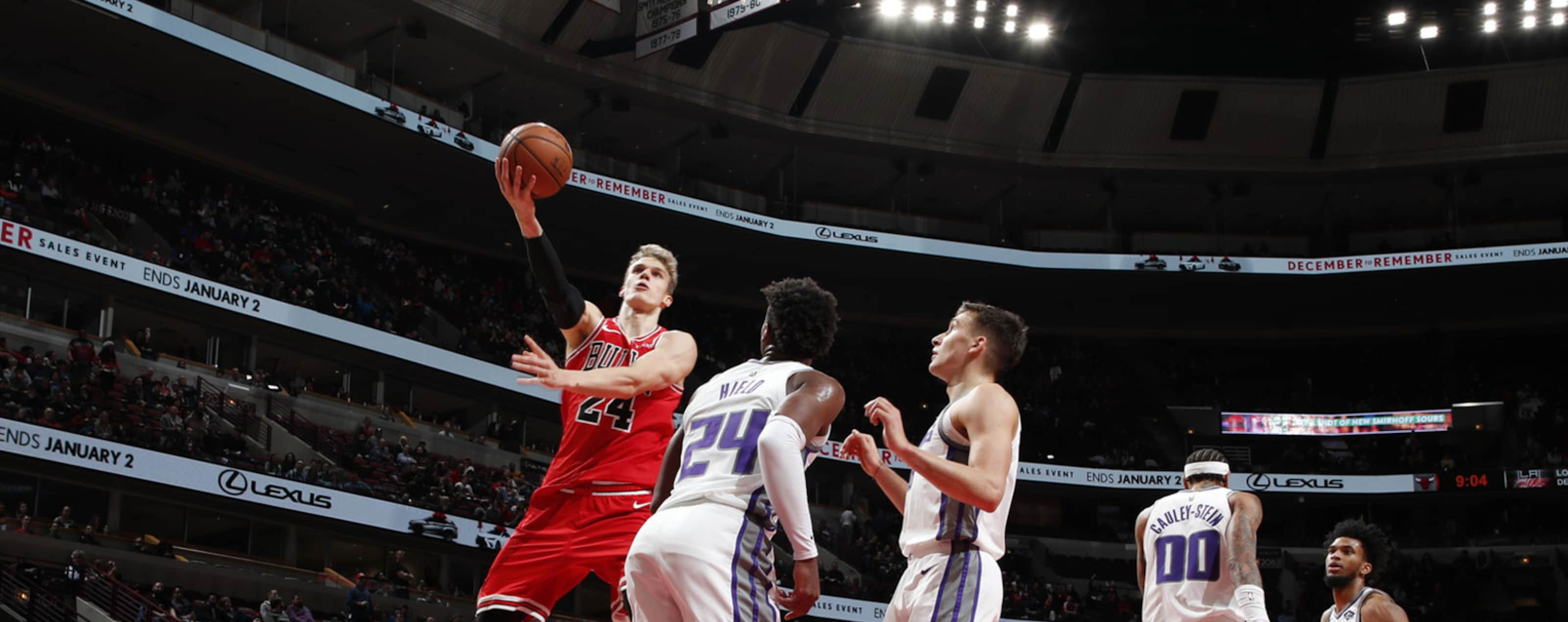 Lauri Markkanen attempts a layup against the Kings