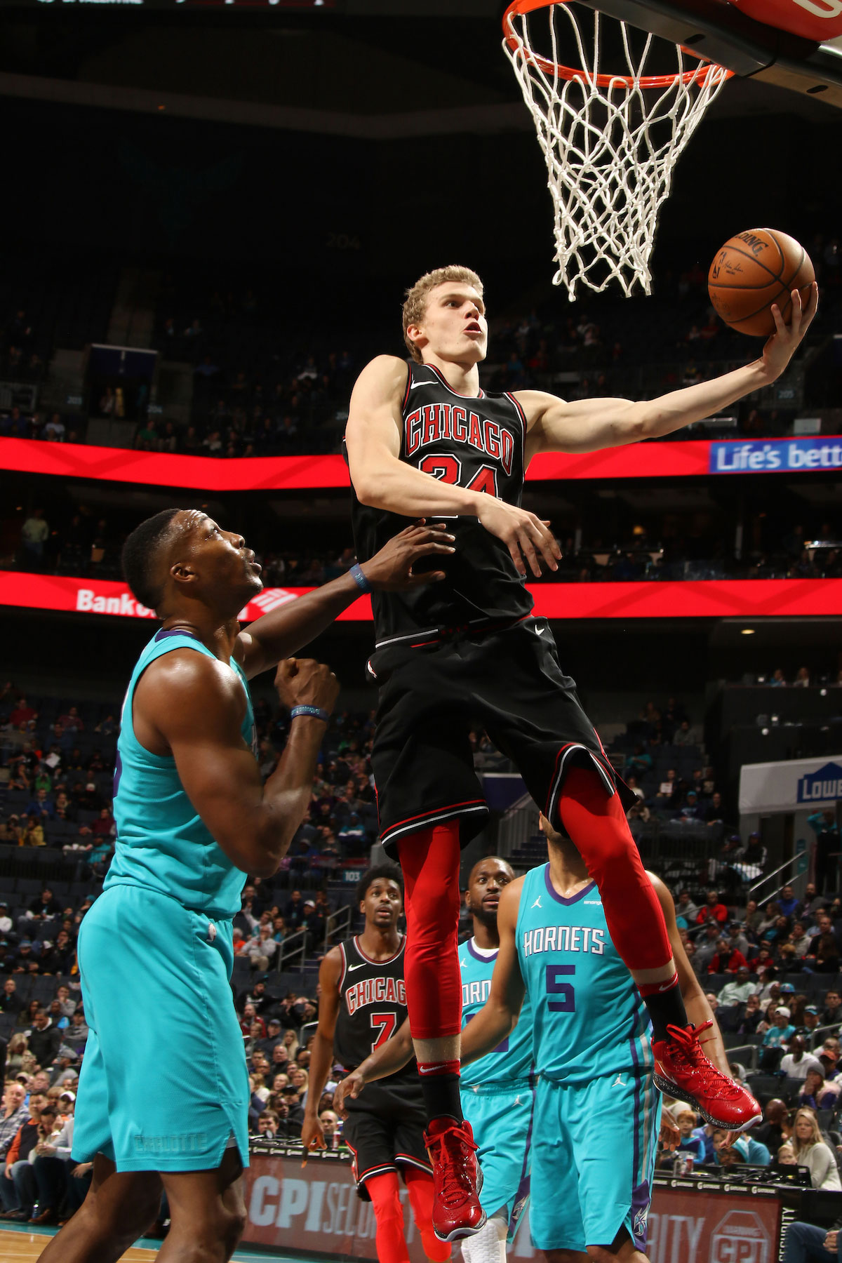 Lauri Markkanen #24 of the Chicago Bulls shoots a lay up against the Charlotte Hornets on December 8, 2017 at Spectrum Center in Charlotte, North Carolina.