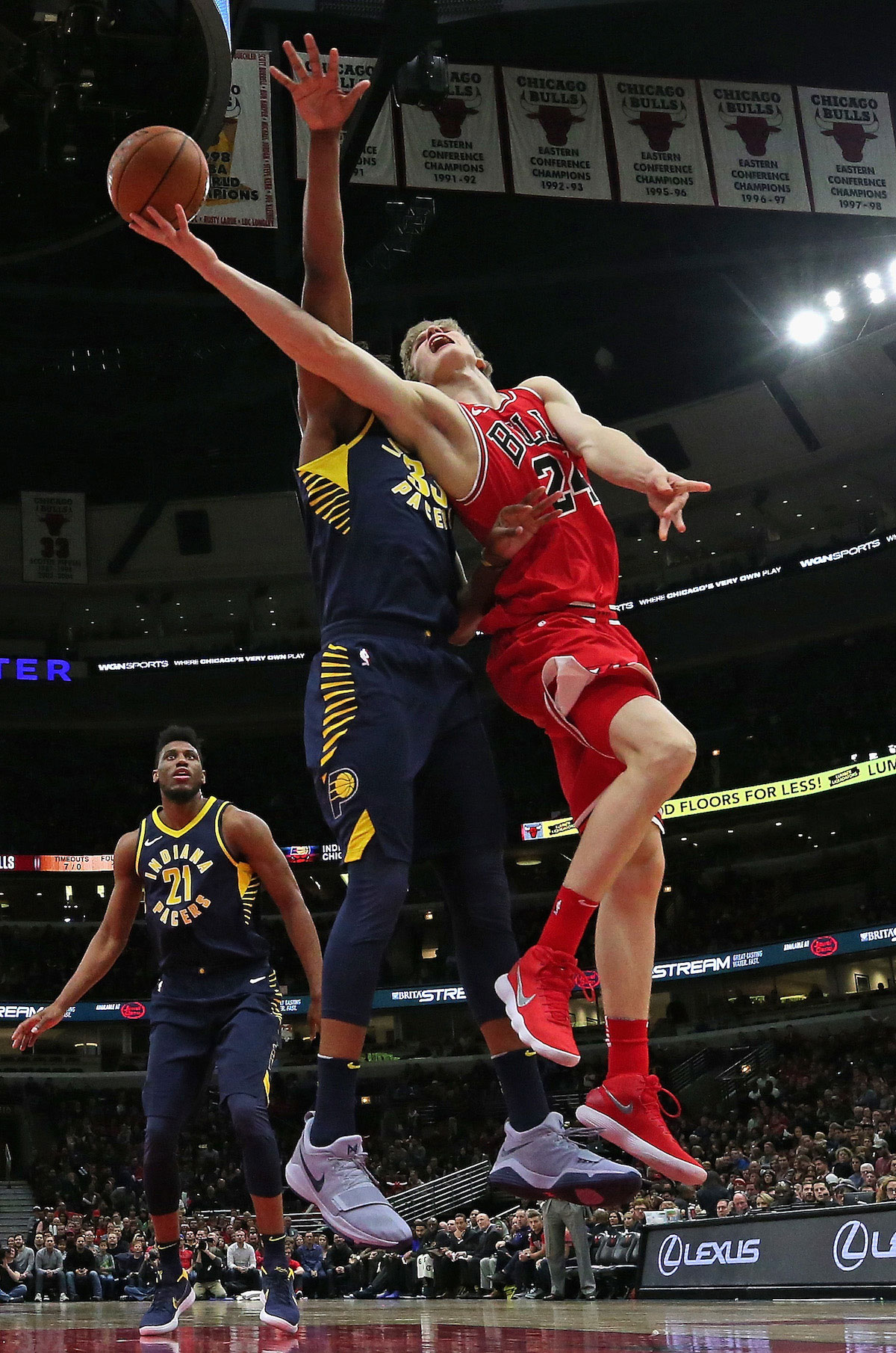 Lauri Markkanen #24 of the Chicago Bulls puts up a shot against Myles Turner #33 of the Indiana Pacers