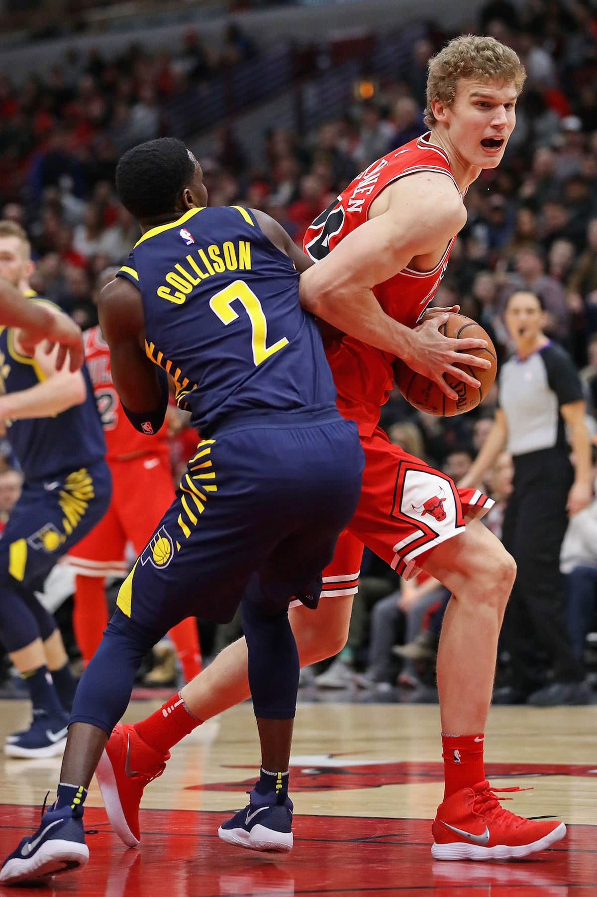 Lauri Markkanen #24 of the Chicago Bulls moves against Darren Collison #2 of the Indiana Pacers