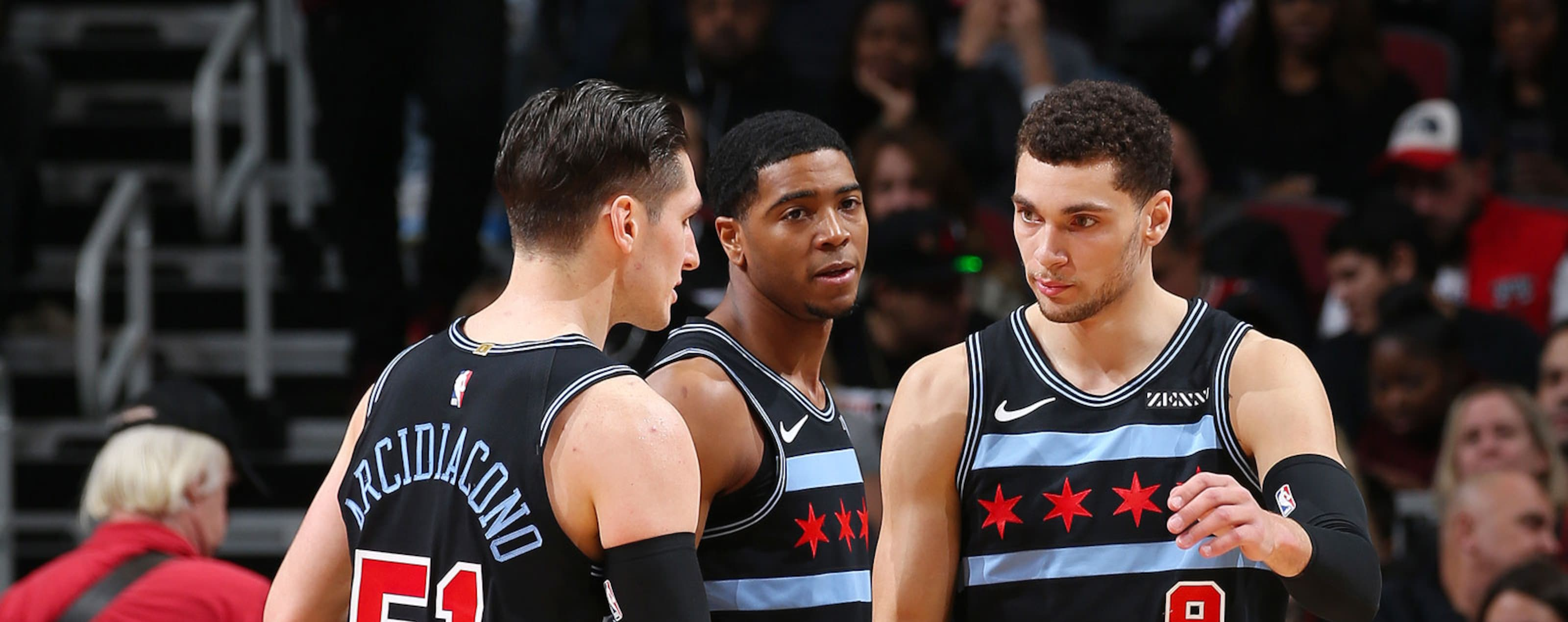 Zach LaVine #8 celebrates with Ryan Arcidiacono #51 of the Chicago Bulls during the game against the Minnesota Timberwolves on December 26, 2018 at the United Center in Chicago, Illinois.