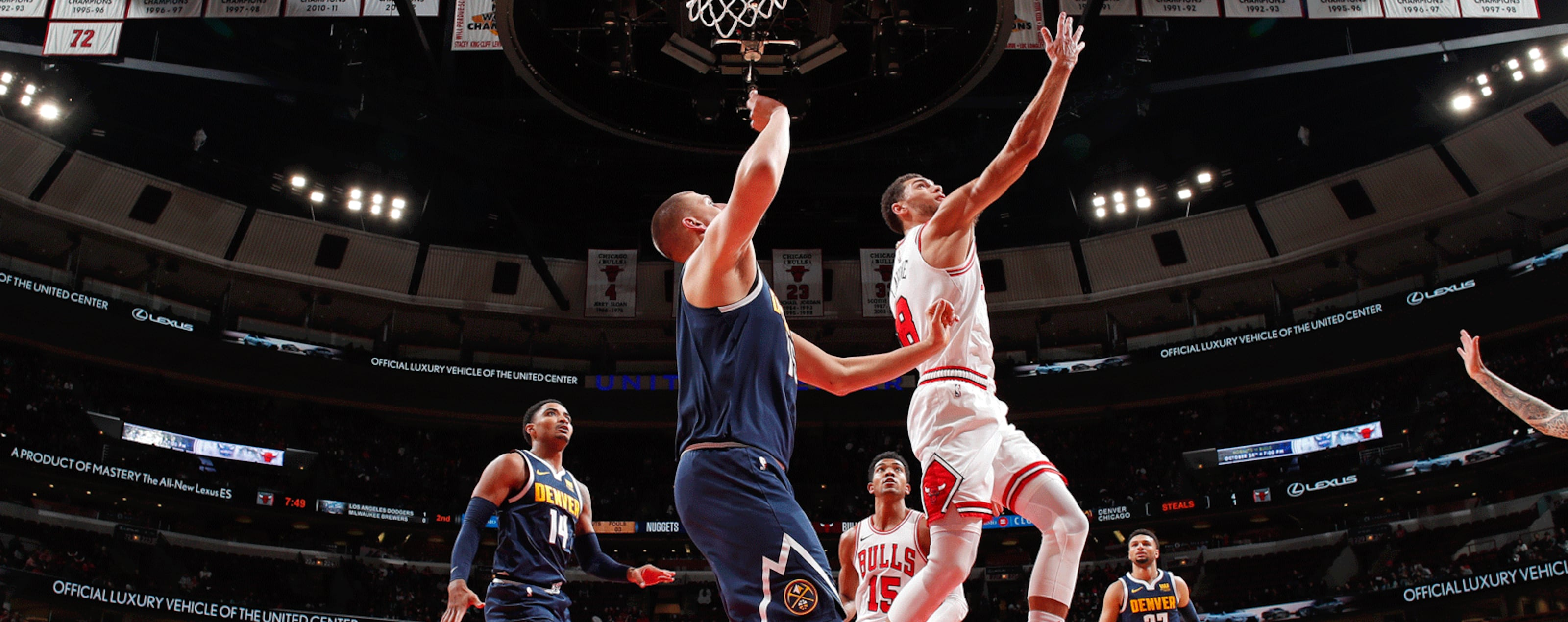Zach LaVine #8 of the Chicago Bulls drives to the basket against the Denver Nuggets during a pre-season game on October 12, 2018 at the United Center in Chicago, Illinois.