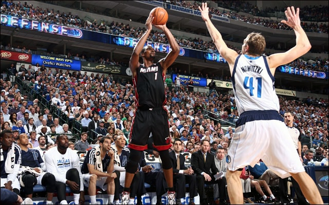Bosh puts up a jumper over Nowitzki