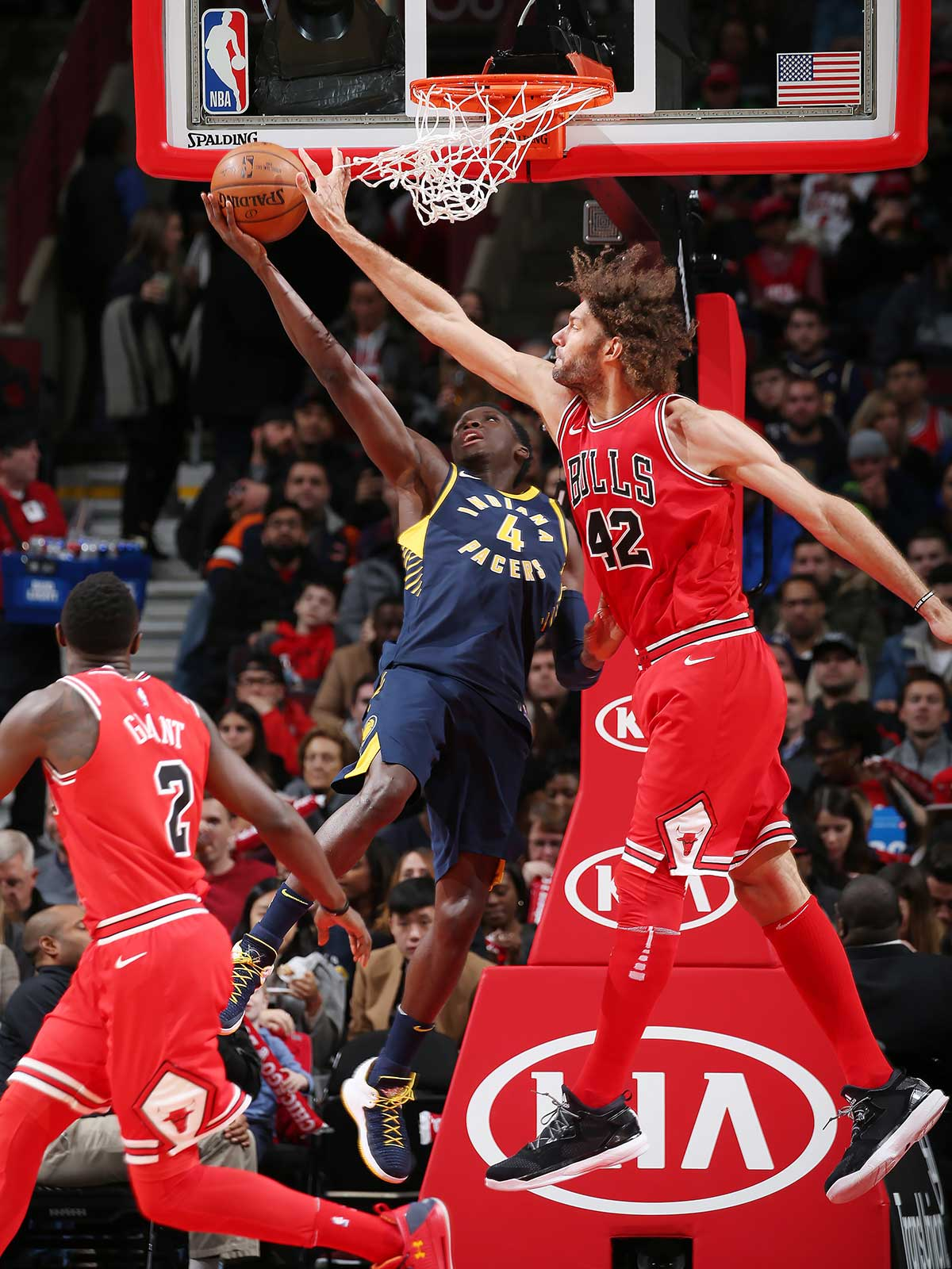 Victor Oladipo #4 of the Indiana Pacers drives to the basket against Robin Lopez #42 of the Chicago Bulls on November 10, 2017 at the United Center in Chicago, Illinois.
