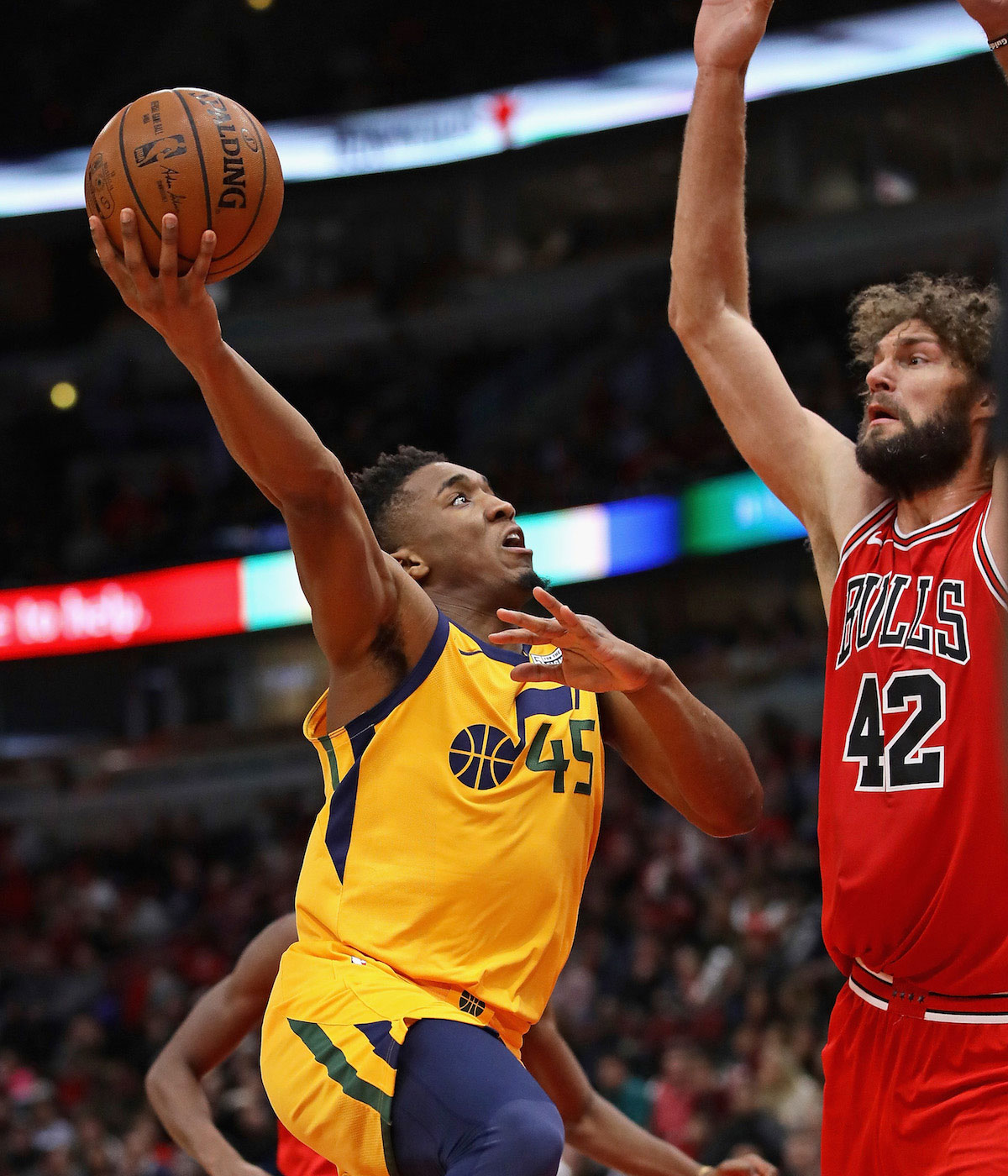 Donovan Mitchell #45 of the Utah Jazz puts up a shot against Robin Lopez #42 of the Chicago Bulls on his way to a game-high 32 points at the United Center on December 13, 2017 in Chicago, Illinois.