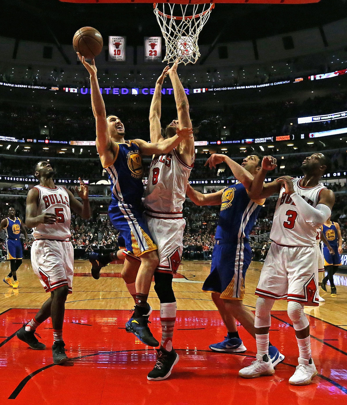 Klay Thompson #11 of the Golden State Warriors puts up a shot against Robin Lopez #8 of the Chicago Bulls