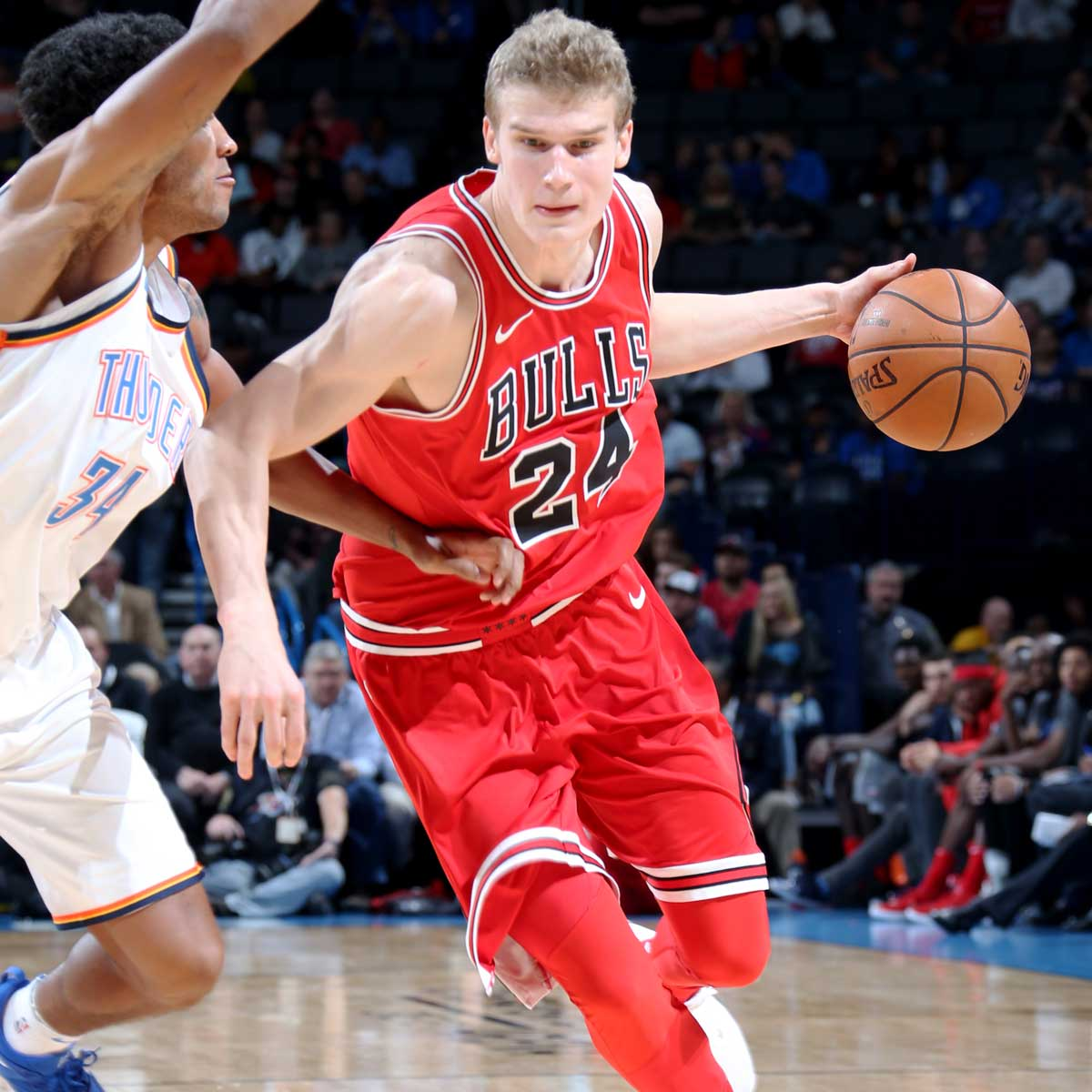 Lauri Markkanen #24 of the Chicago Bulls handles the ball during the game against the Oklahoma City Thunder on November 15, 2017 at Chesapeake Energy Arena in Oklahoma City, Oklahoma.