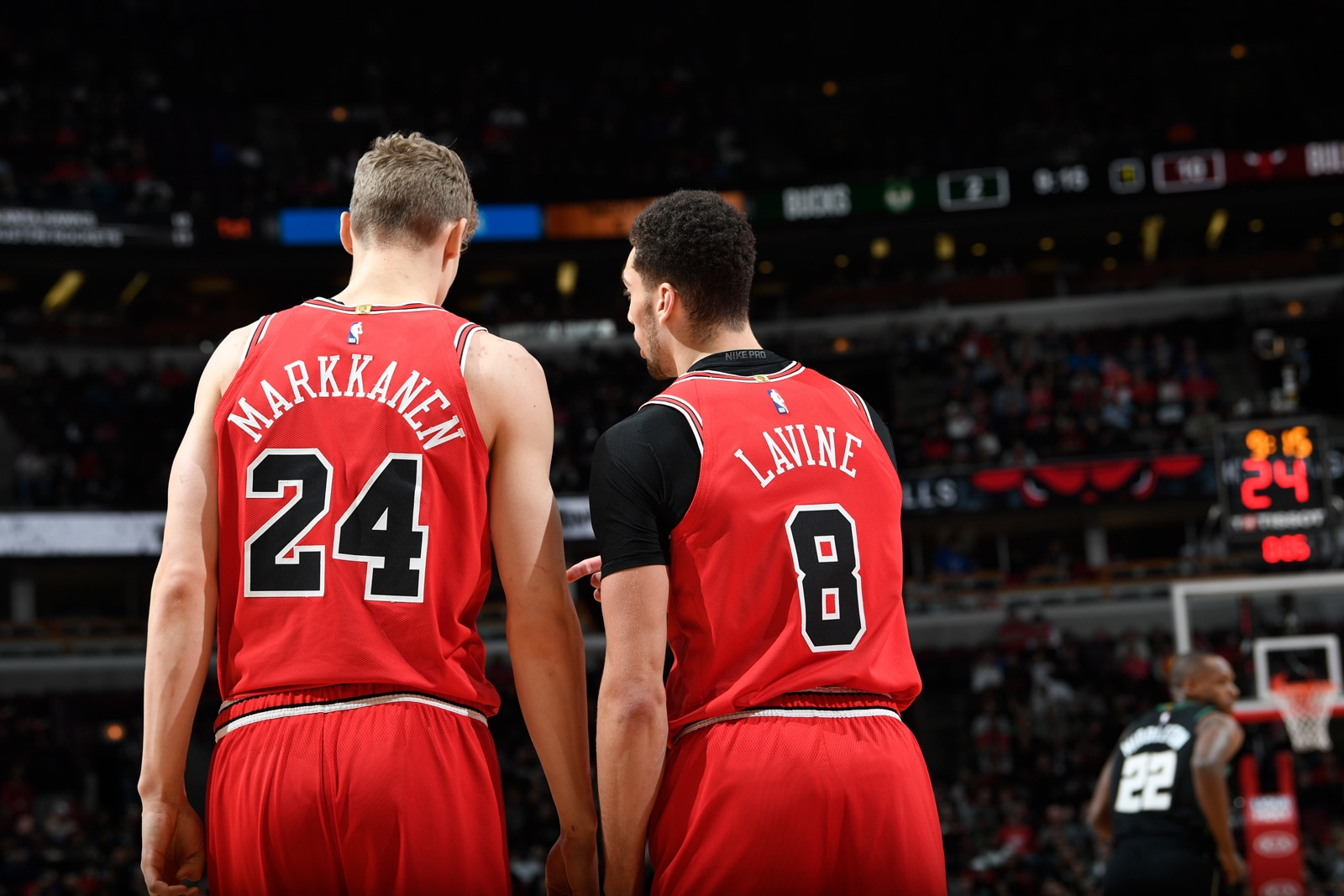 Zach LaVine and Lauri Markkanen discuss during the game