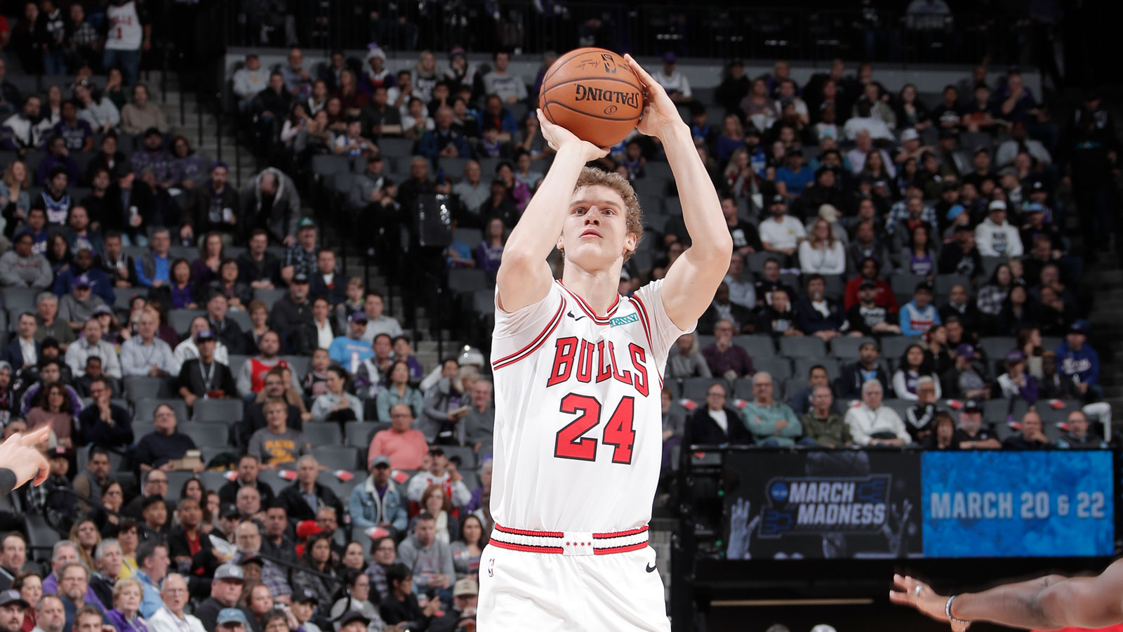 Lauri Markkanen attempts a three against the Kings