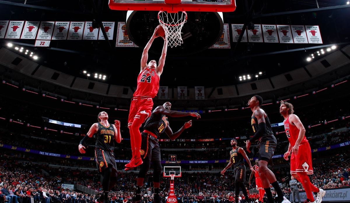 Lauri Markkanen #24 of the Chicago Bulls shoots the ball against the Atlanta Hawks on October 26, 2017 at the United Center in Chicago, Illinois.