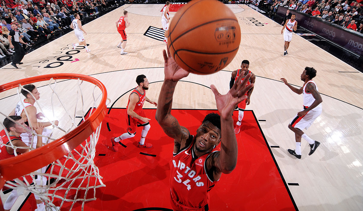 Alfonzo McKinnie #34 of the Toronto Raptors gets the rebound during the game against the Portland Trail Blazers during a preseason game on October 5, 2017 at the Moda Center in Portland, Oregon.