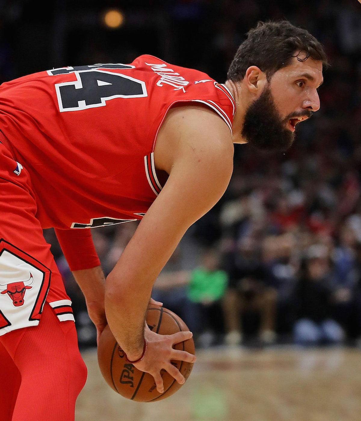 Nikola Mirotic #44 of the Chicago Bulls moves against the Philadelphia 76ers at the United Center on December 18, 2017 in Chicago, Illinois.