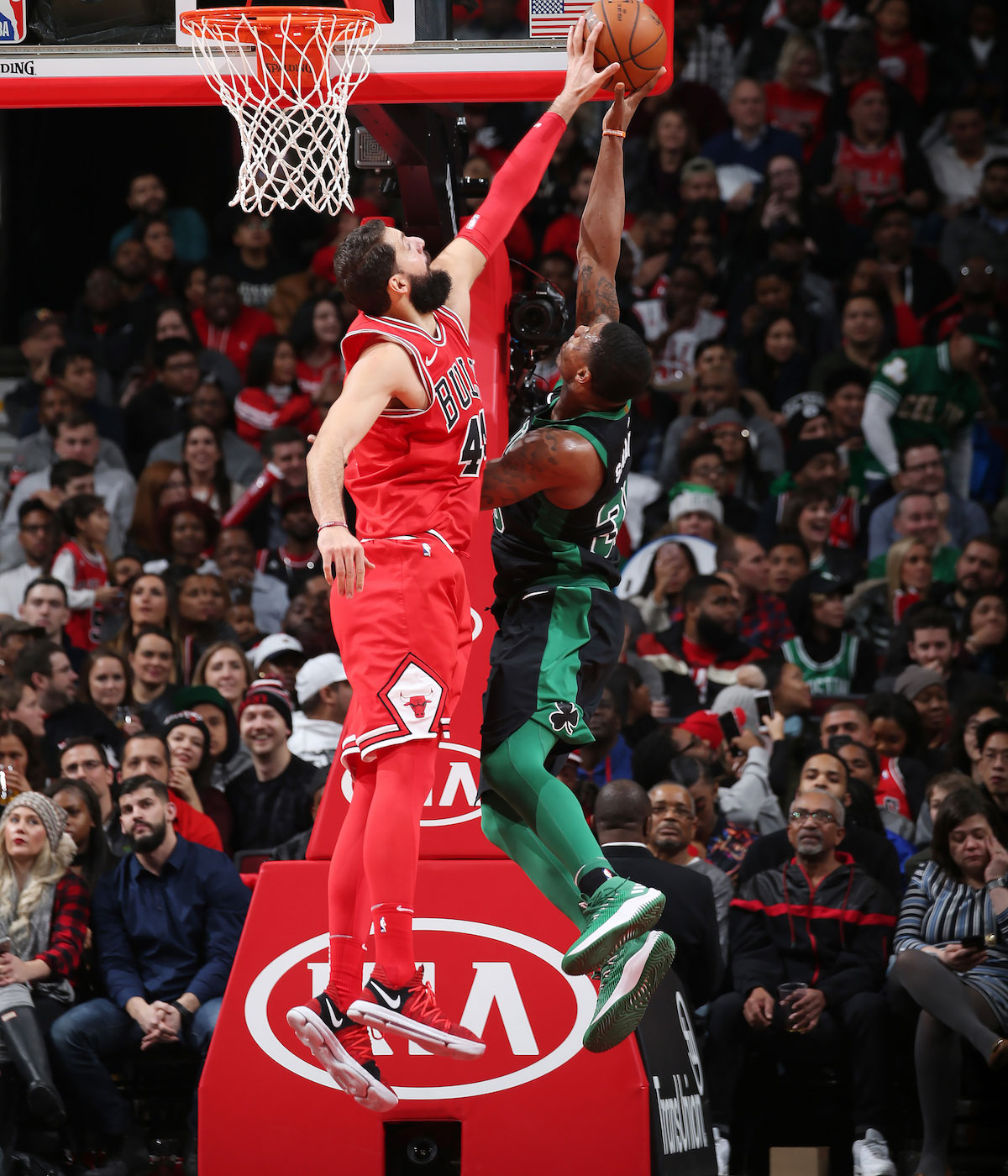 Nikola Mirotic #44 of the Chicago Bulls blocks a shot by Marcus Smart #36 of the Boston Celtics on December 11, 2017 at the United Center in Chicago, Illinois.