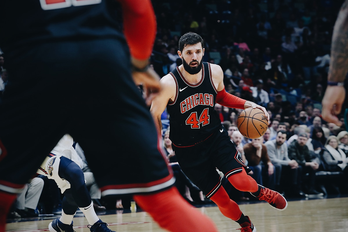 Mirotic dribbles the ball up the court