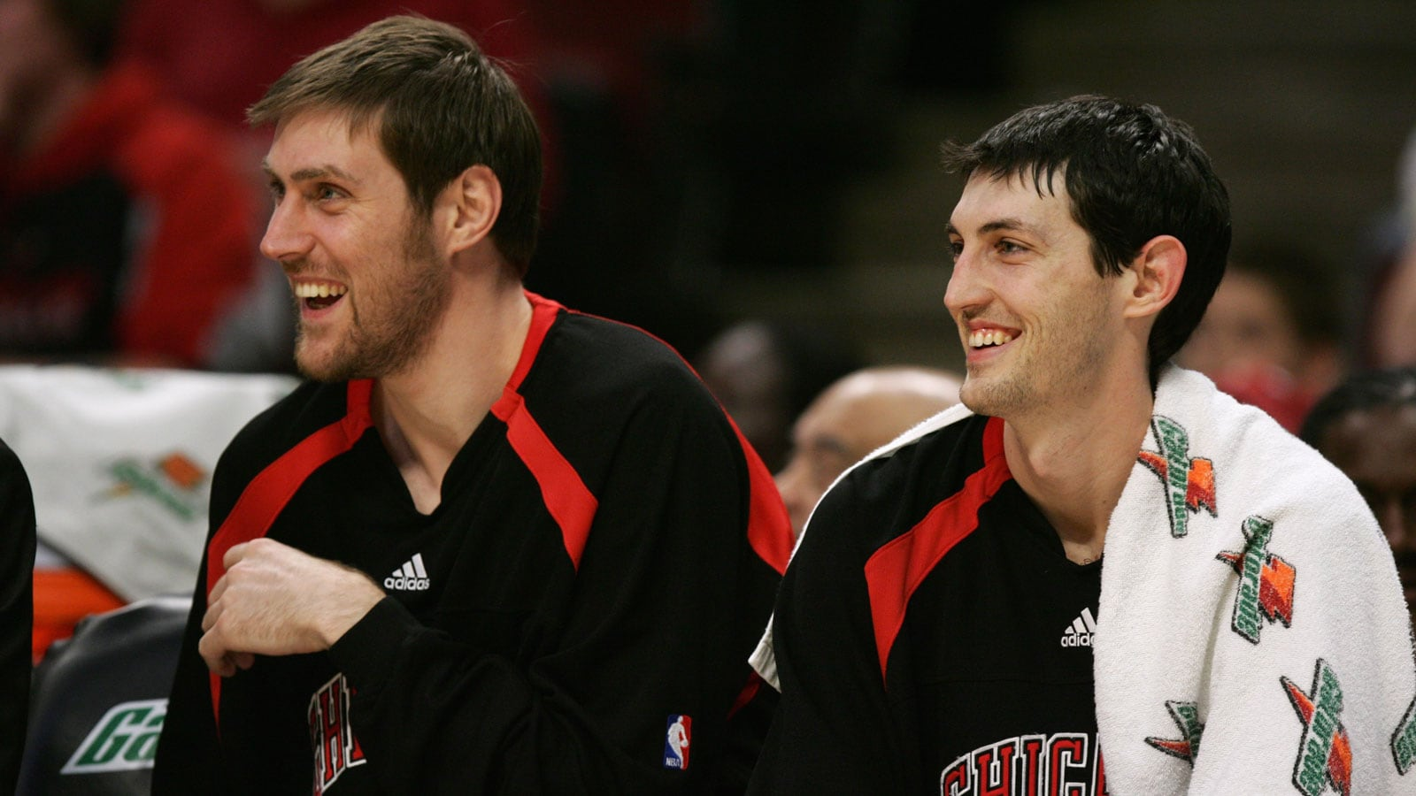 Andres Nocioni #5 and Kirk Hinrich #12 of the Chicago Bulls smile during the game against the New Jersey Nets on April 6, 2007 at the United Center
