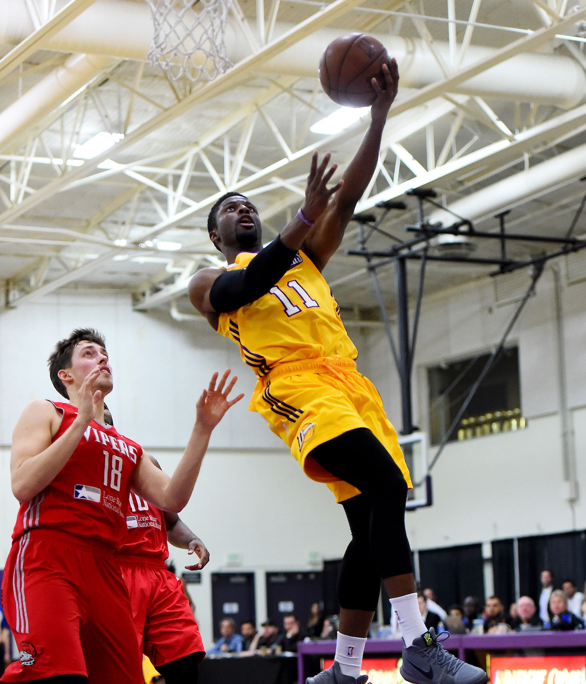 David Nwaba #11 of the Los Angeles D-Fenders goes to the basket against Kyle Wiltjer #18 of the Rio Grande Valley Vipers in Game Three of the Western Division SemiFinals on April 10, 2017 at Toyota Sports Center in El Segundo, California.