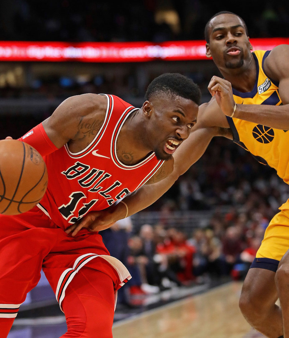 David Nwaba #11 of the Chicago Bulls drives past Alec Burks #10 of the Utah Jazz at the United Center on December 13, 2017 in Chicago, Illinois