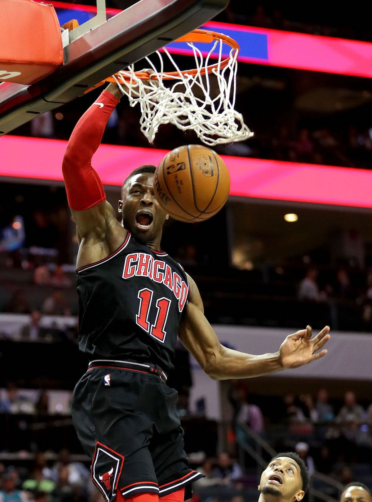 David Nwaba #11 of the Chicago Bulls dunks the ball against Jeremy Lamb #3 of the Charlotte Hornets during their game at Spectrum Center on February 27, 2018 in Charlotte, North Carolina.
