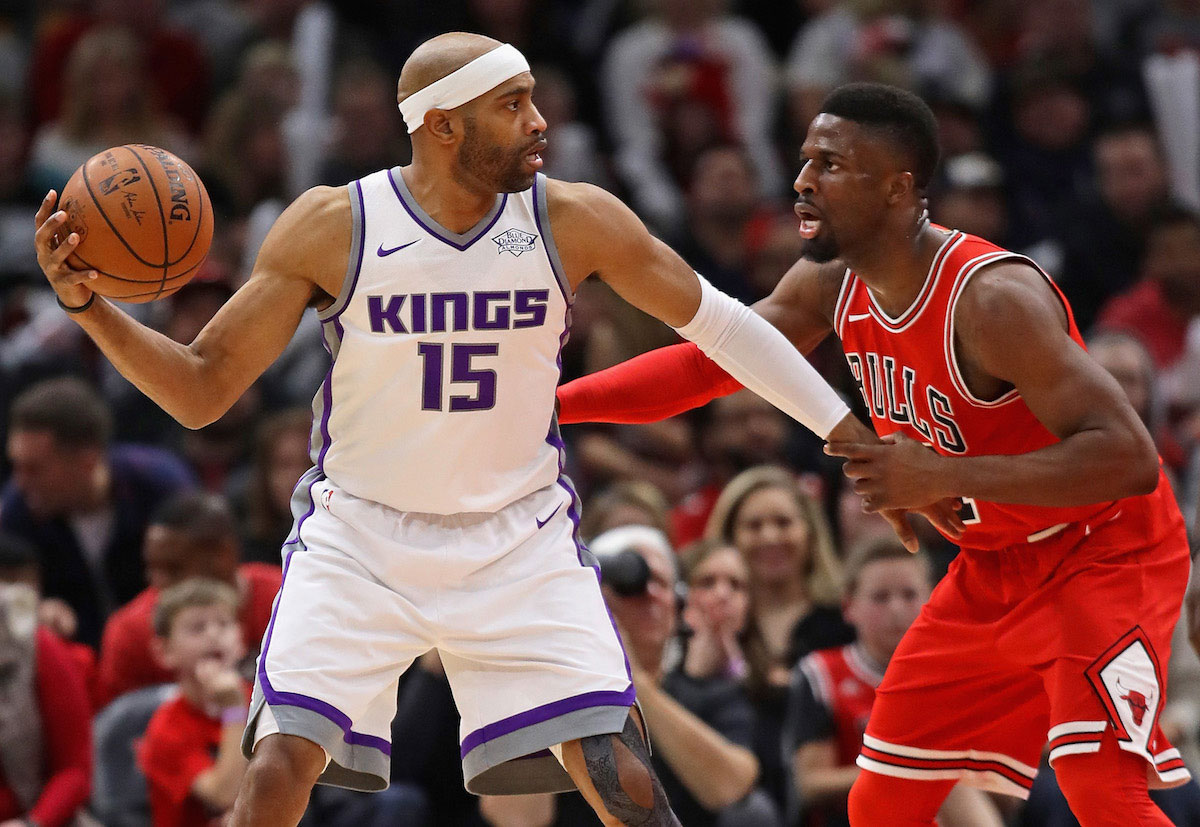 Vince Carter #15 of the Sacramento Kings looks to pass against David Nwaba #11 of the Chicago Bulls at the United Center on December 1, 2017 in Chicago, Illinois.
