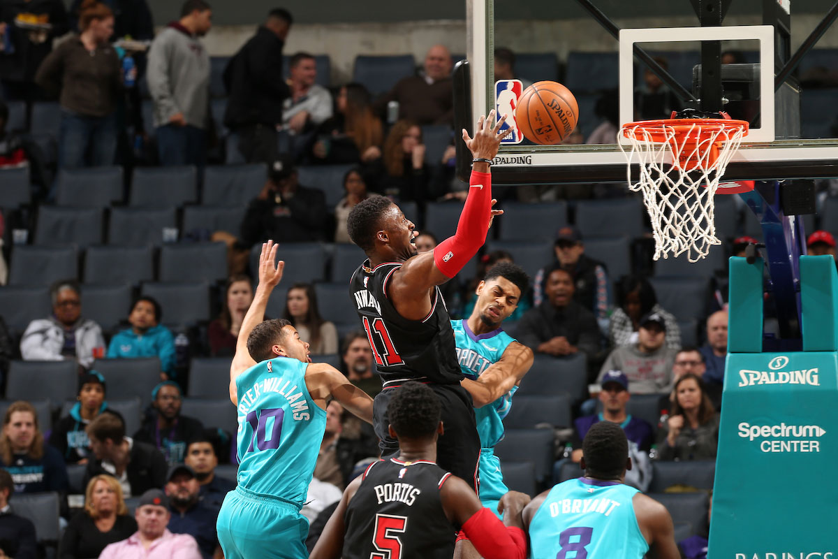 David Nwaba #11 of the Chicago Bulls goes to the basket against the Charlotte Hornets on December 8, 2017 at Spectrum Center in Charlotte, North Carolina.