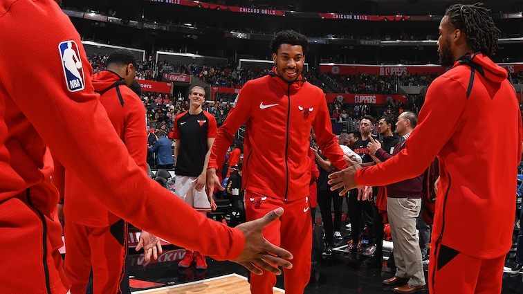 Otto Porter Jr high fives teammates as he's called in the starting lineup