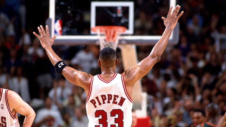 Scottie Pippen with his hands up in celebration