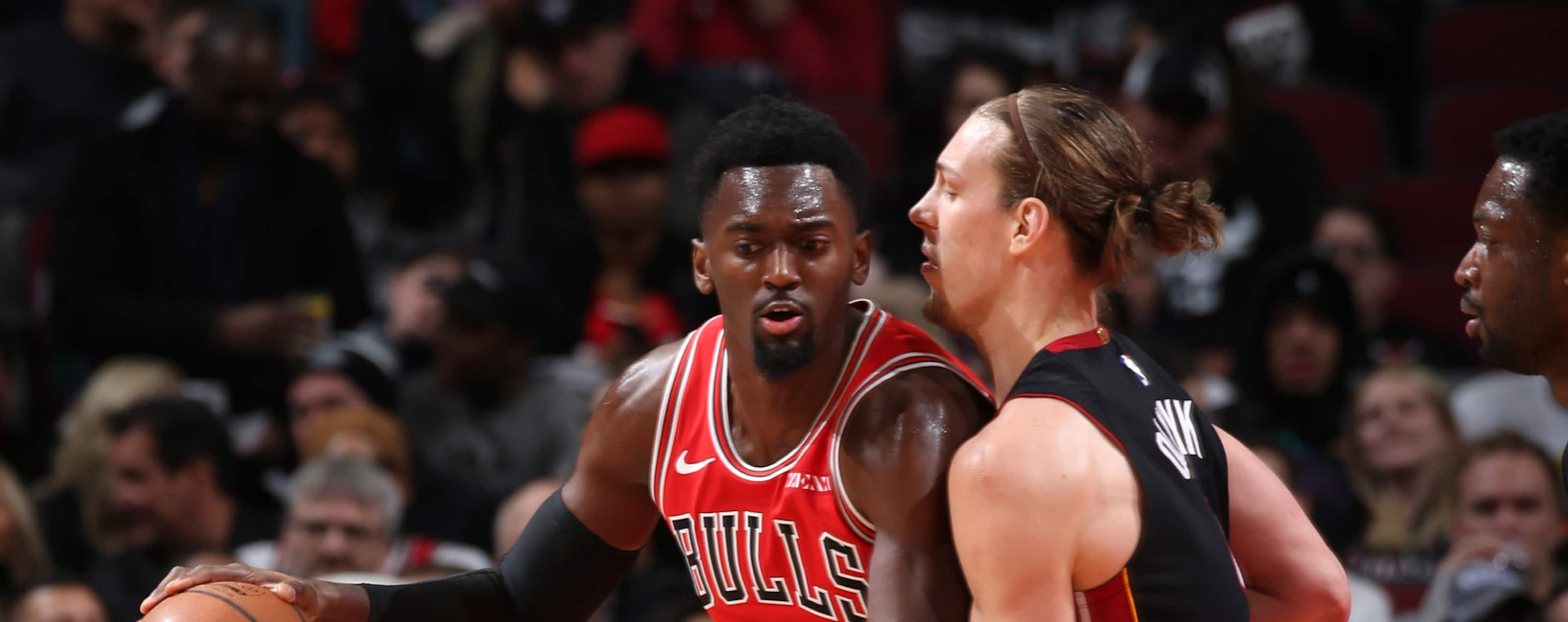 Bobby Portis #5 of the Chicago Bulls posts up on Kelly Olynyk #9 of the Miami Heat on January 19, 2019 at the United Center in Chicago, Illinois.