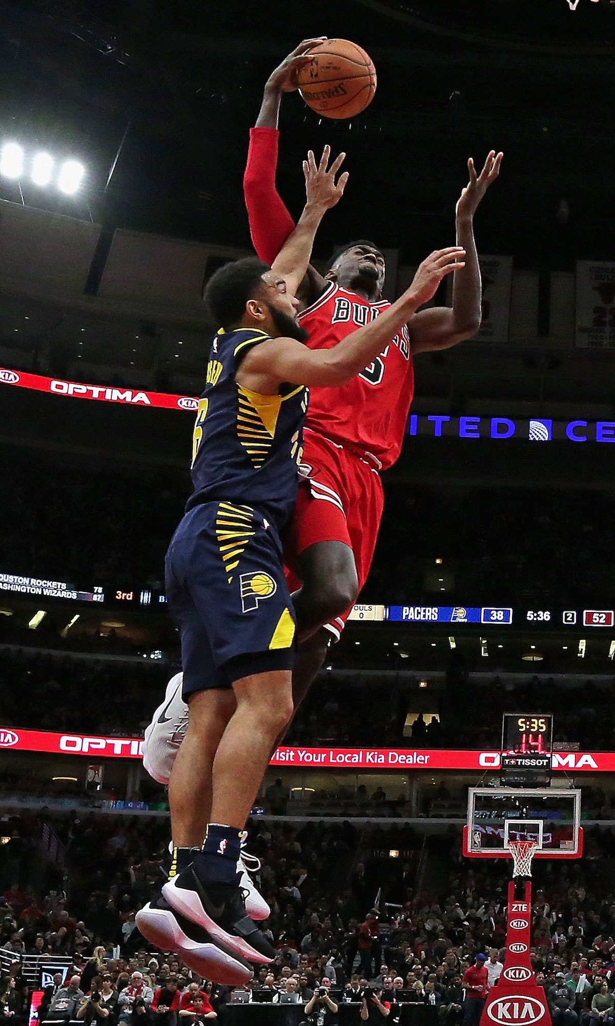 Bobby Portis #5 of the Chicago Bulls tries to get off a shot under pressure from Cory Joseph #6 of the Indiana Pacers