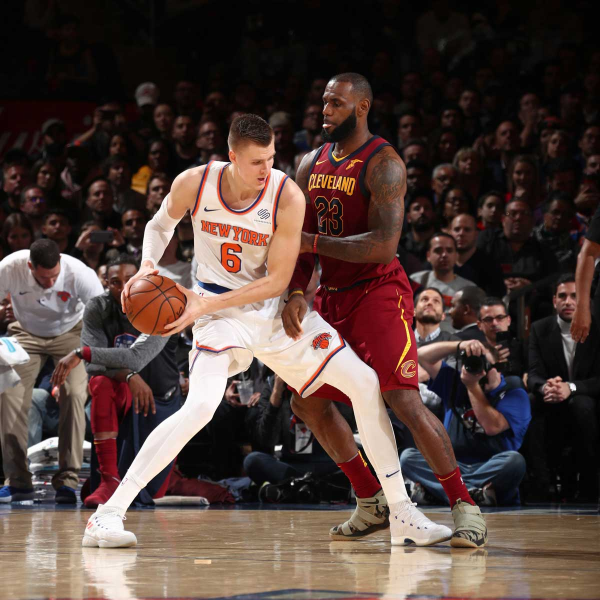 LeBron James #23 of the Cleveland Cavaliers defends Kristaps Porzingis #6 of the New York Knicks on November 13, 2017 at Madison Square Garden in New York City, New York.