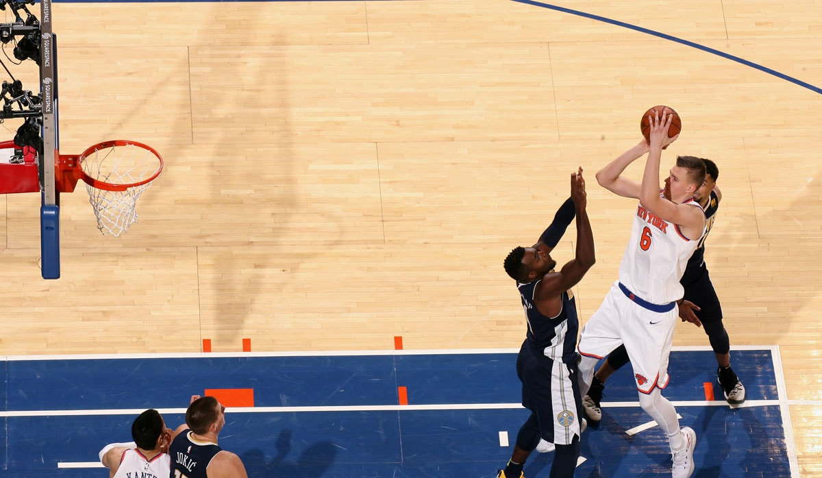 Kristaps Porzingis #6 of the New York Knicks shoots the ball against the Denver Nuggets on October 30, 2017 at Madison Square Garden in New York City, New York.