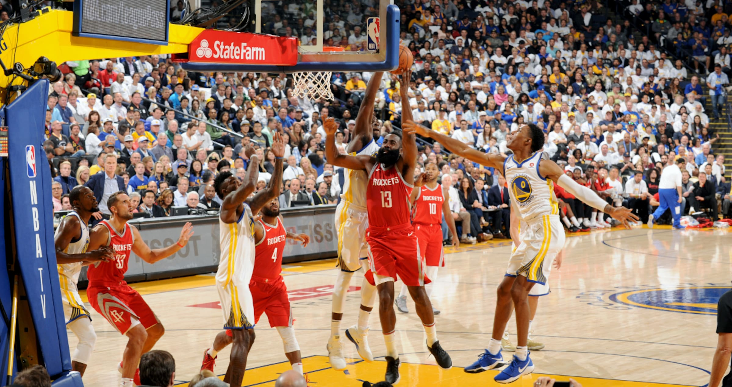 James Harden #13 of the Houston Rockets goes to the basket against the Golden State Warriors on October 17, 2017 at ORACLE Arena in Oakland, California.