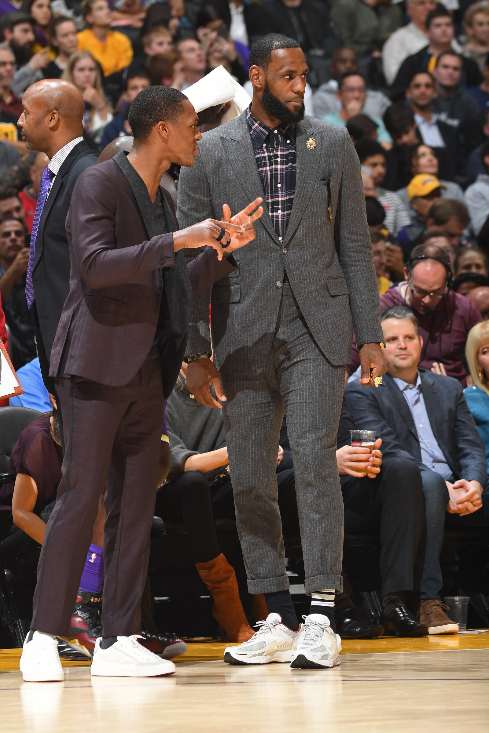Lebron and Rajon Rondo talk courtside during Lakers game.