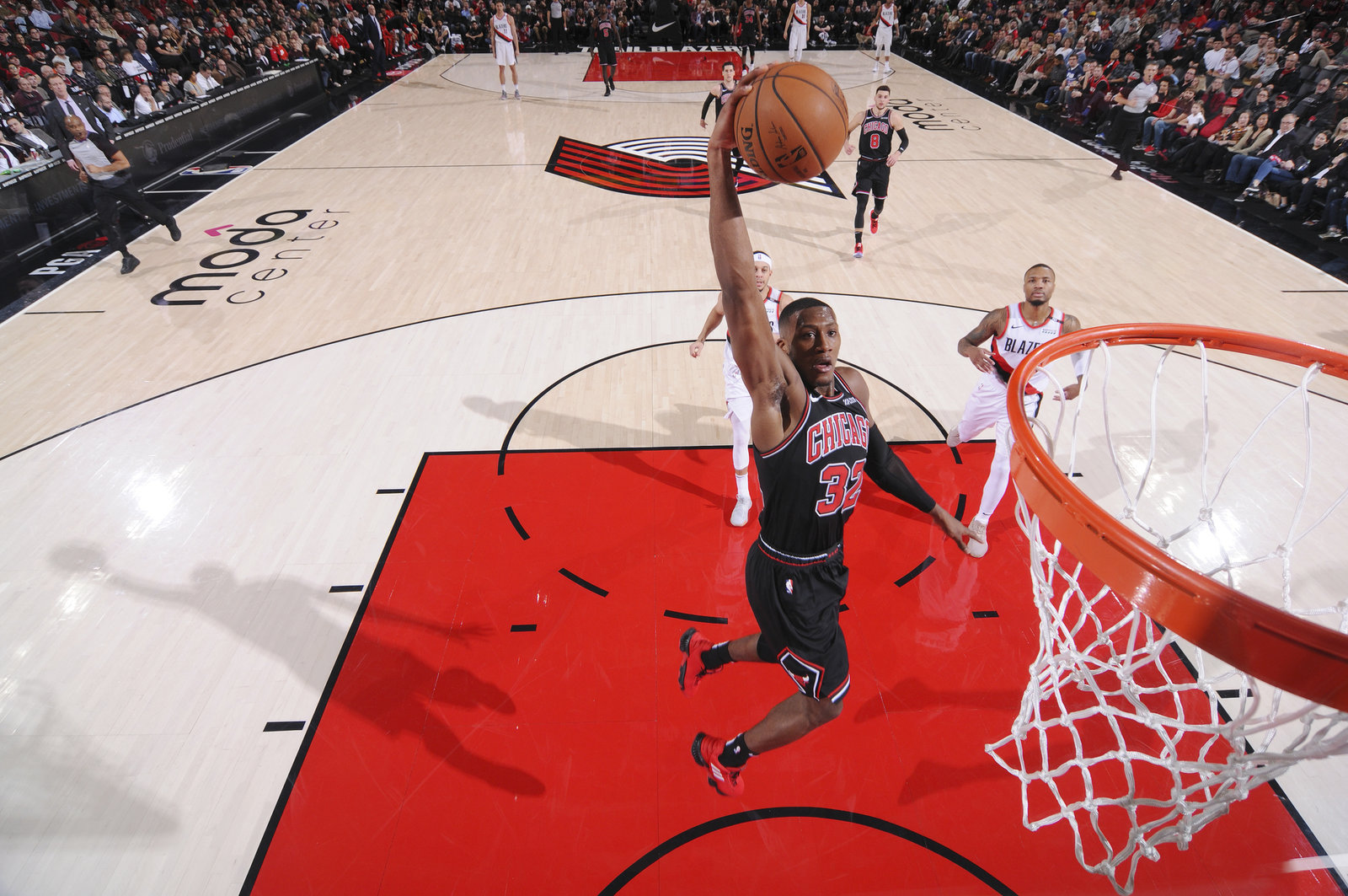 Kris Dunn drives to rim against the Portland Trailblazers.