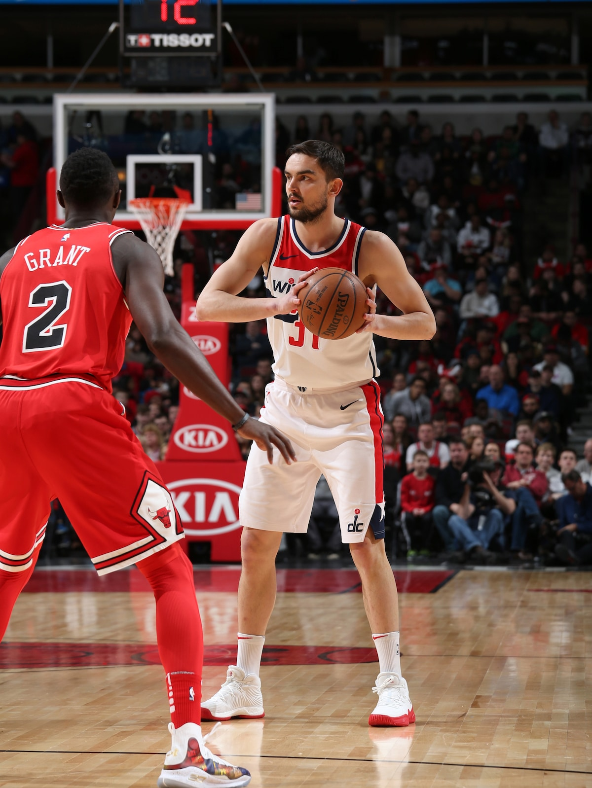 Satoransky of the Washington Wizards holds the ball as Jerian Grant of the Chicago Bulls is on defense.