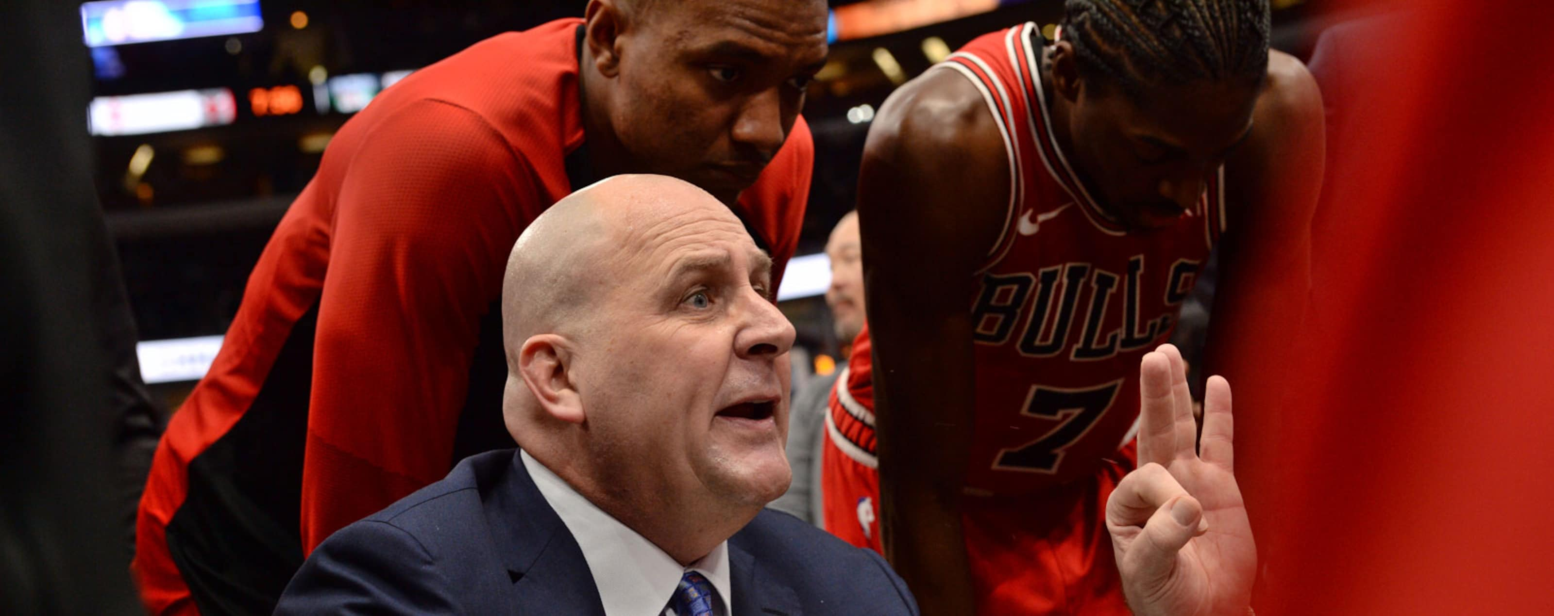 Coach Jim Boylen during a team huddle surrounded by players Wendell Carter Jr. and Justin Holiday.