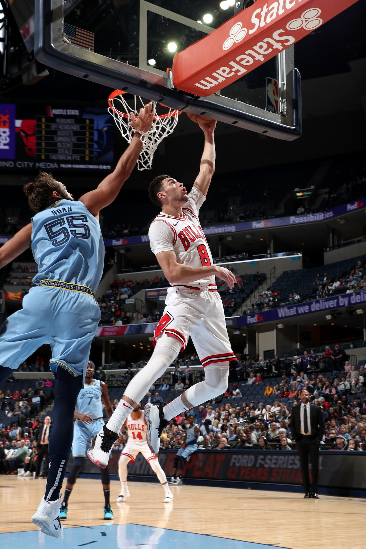 Zach LaVine goes for the layup against Joakim Noah of the Memphis Grizzlies