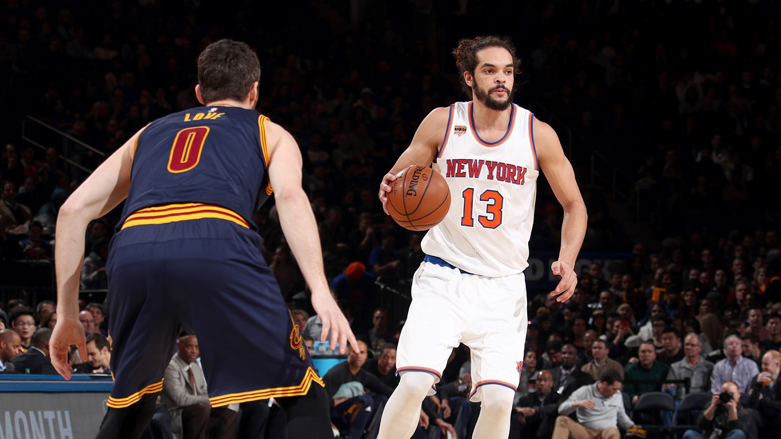 04dcdc5e186 Joakim Noah of the New York Knicks dribbles the ball up against Kevin Love  of the.