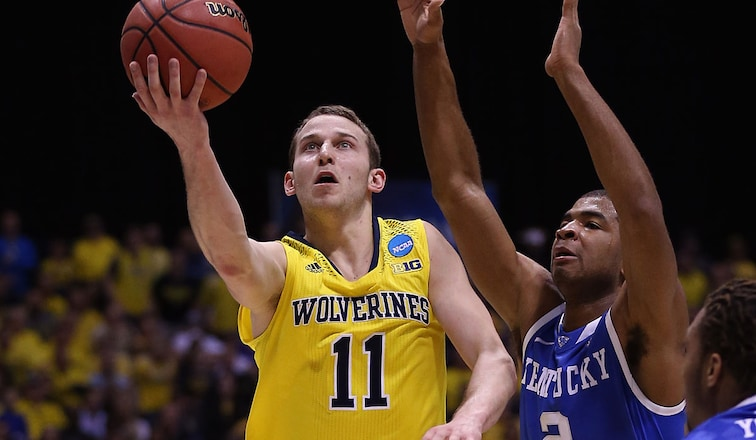Nik Stauskas goes to the basket against Kentucky