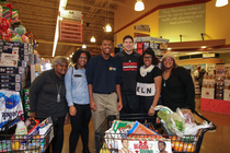 Aaron Brooks and Doug Mcdermott take five families grocery shopping during holiday season