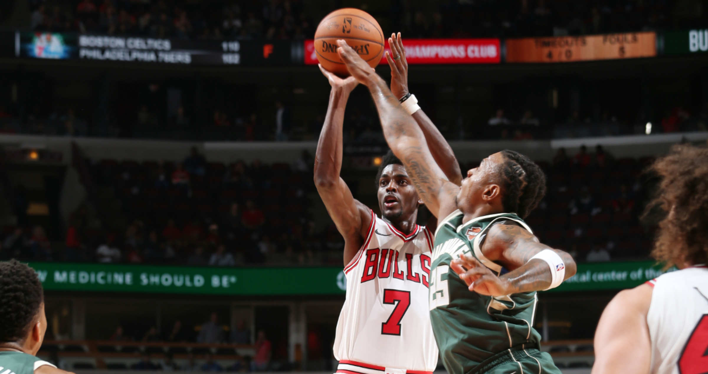 Justin Holiday of the Chicago Bulls attempting a jumper against players of the Milwaukee Bucks at the United Center, October 6, 2017