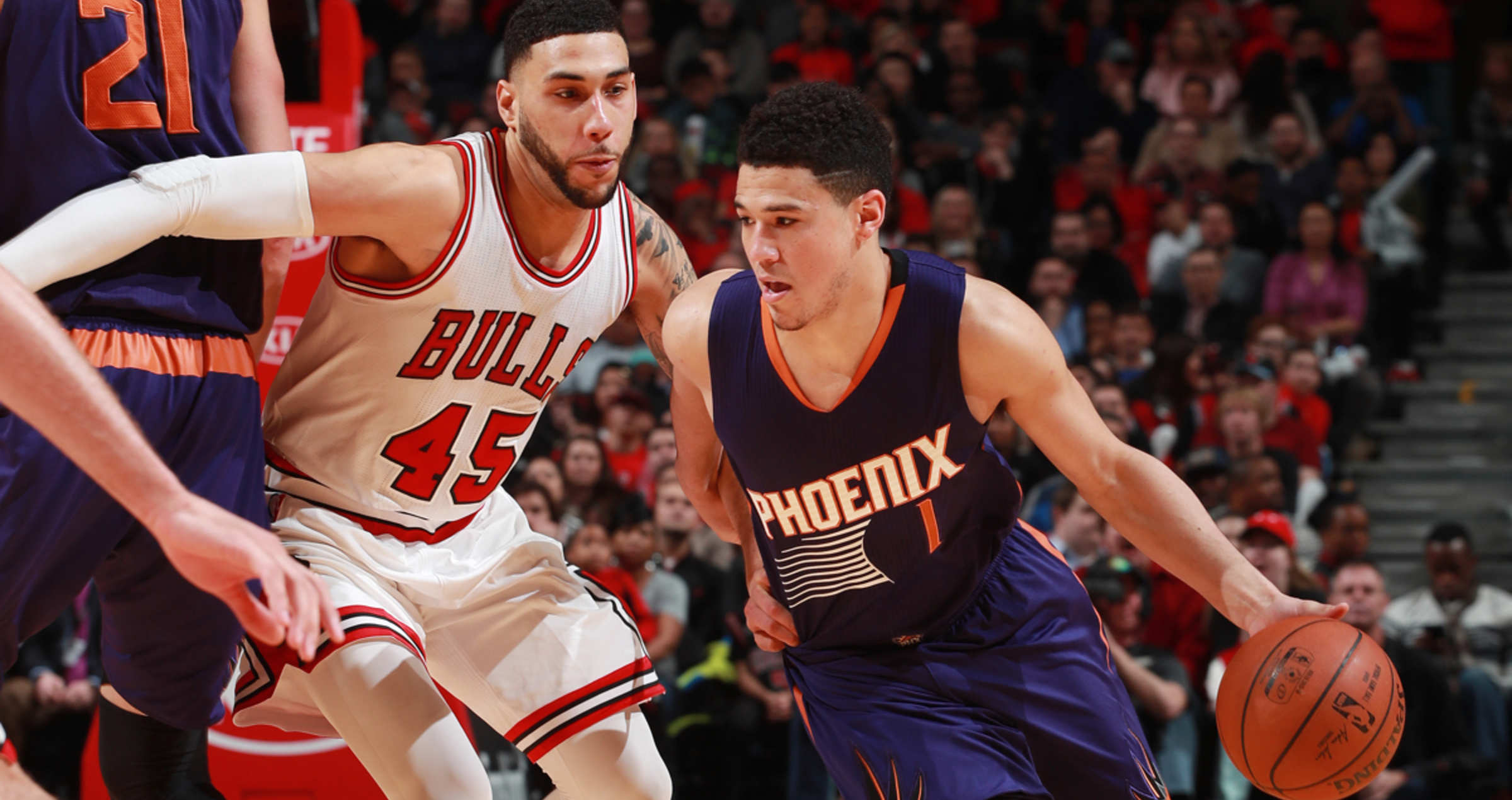 FEBRUARY 24: Devin Booker #1 of the Phoenix Suns drives to the basket against Denzel Valentine #45 of the Chicago Bulls during the game on February 24, 2017 at the United Center in Chicago, Illinois.