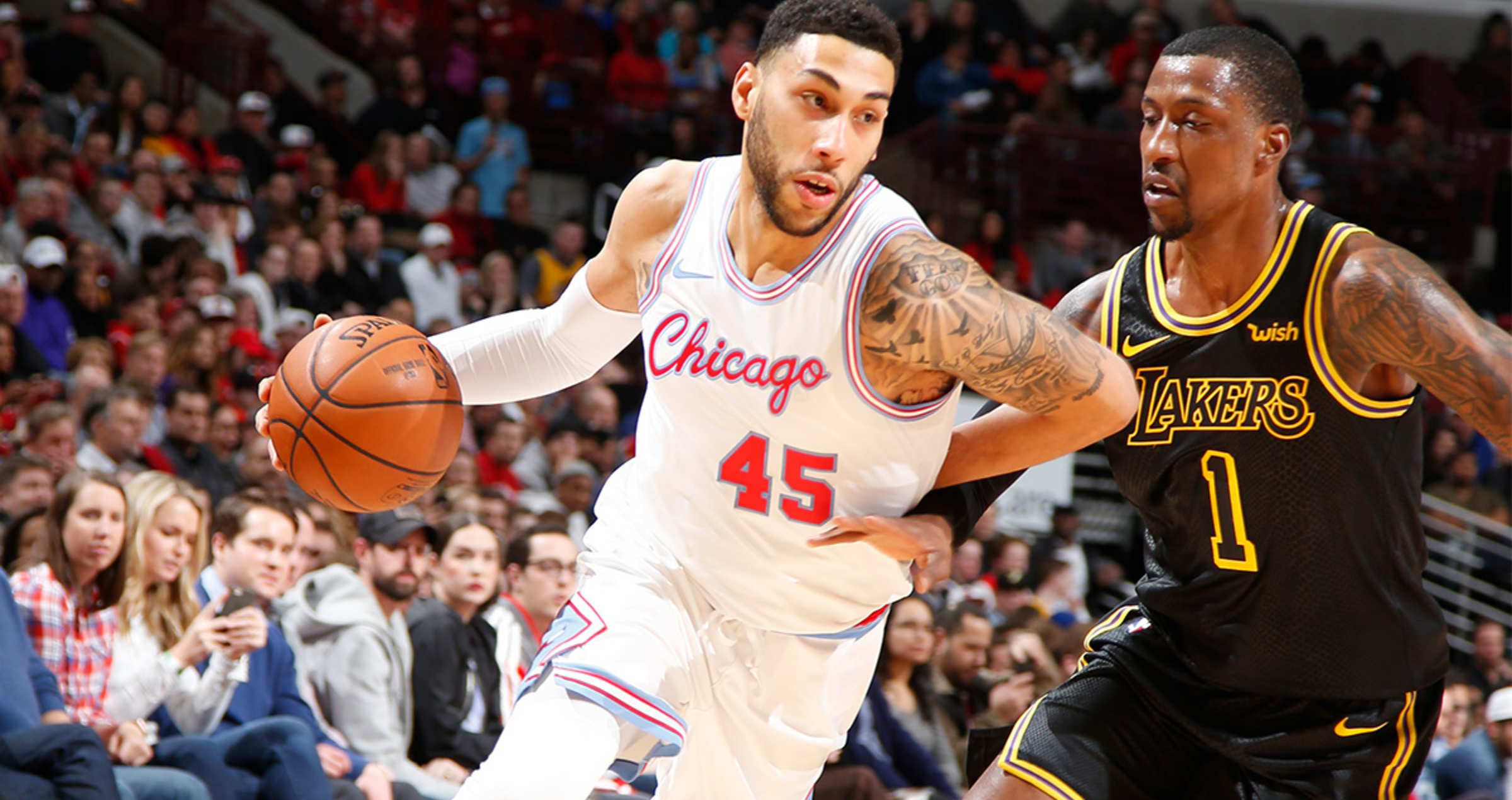 Denzel Valentine drives to the basket against the Los Angeles Lakers