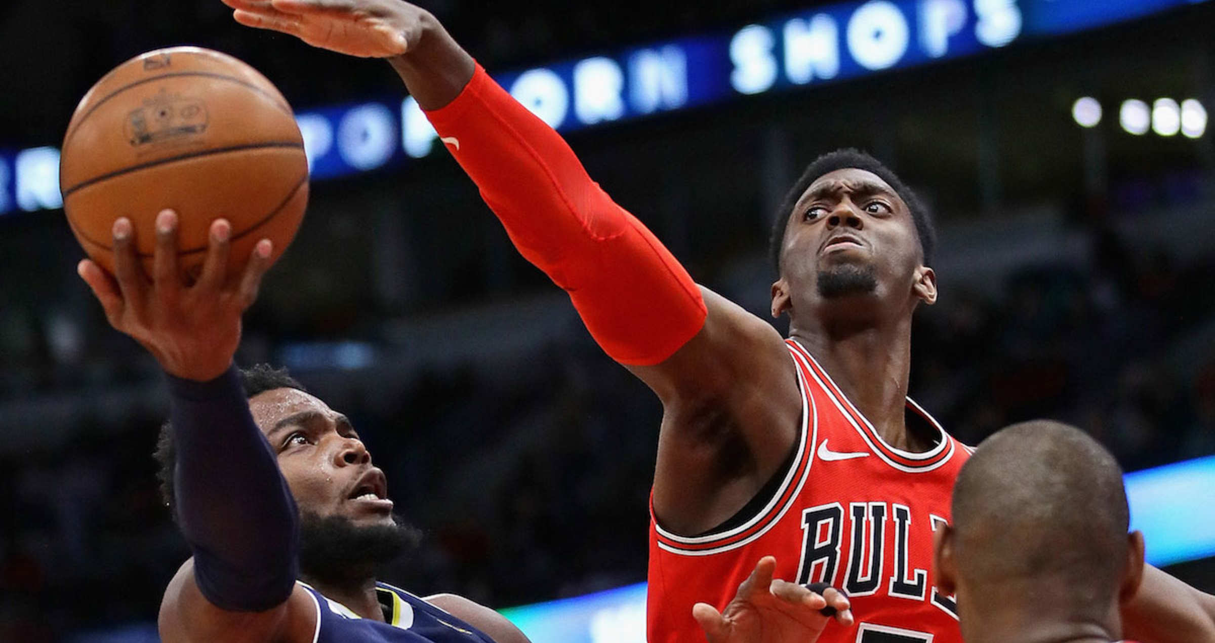 Paul Millsap #4 of the Denver Nuggets goes up against Bobby Portis #5 and Cristiano Felicio #6 of the Chicago Bulls at the United Center on March 21, 2018 in Chicago, Illinois.