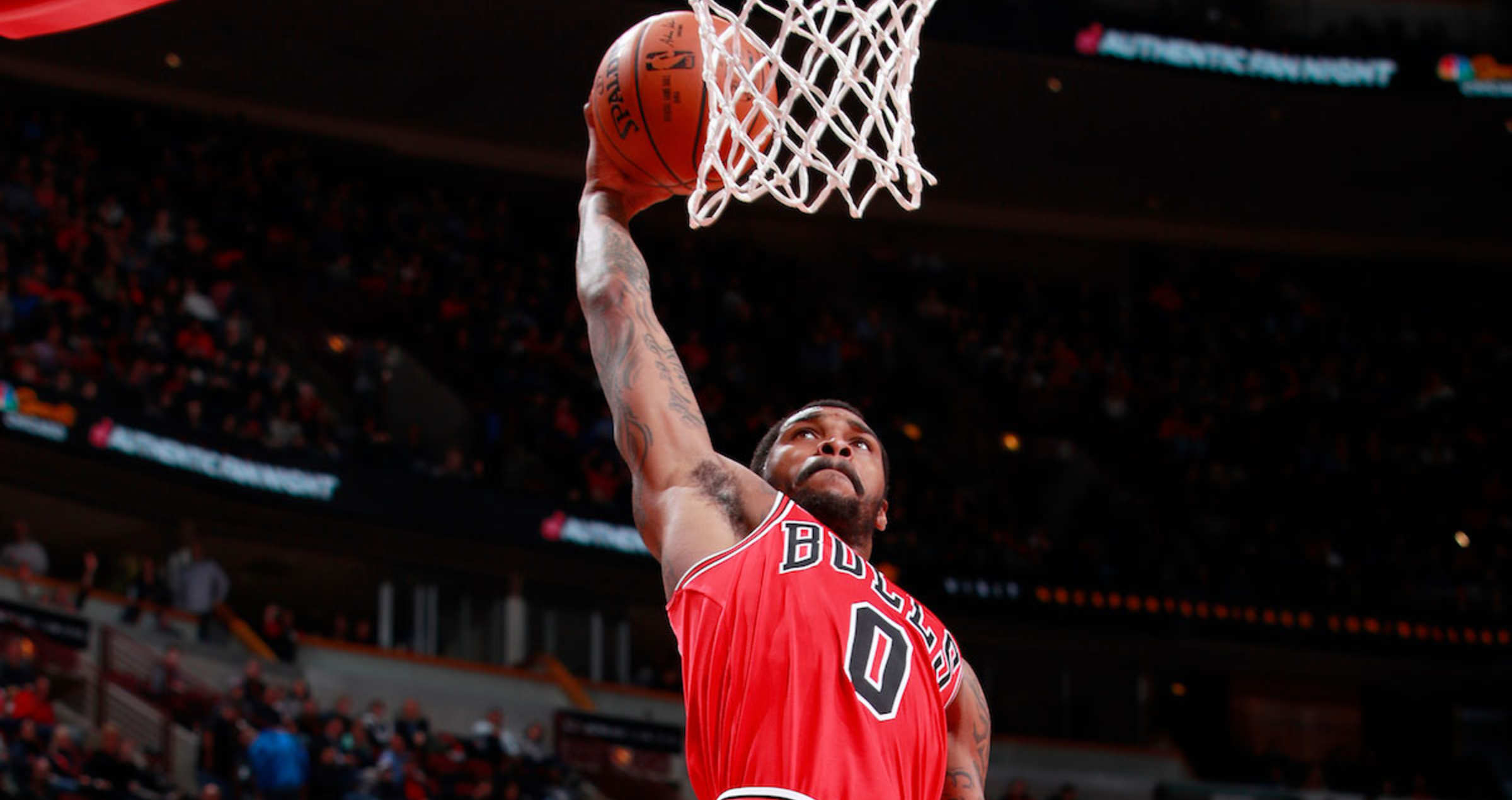 d85bddb7ff42 Sean Kilpatrick  0 of the Chicago Bulls goes up for a dunk against the  Charlotte