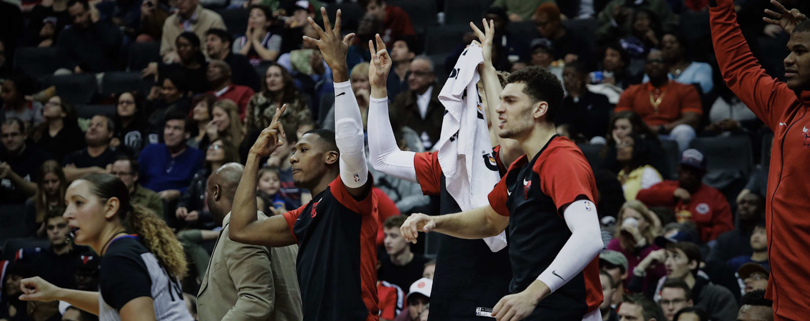 Zach LaVine, Kris Dunn and Lauri Markkanen react on the bench against the Wizards