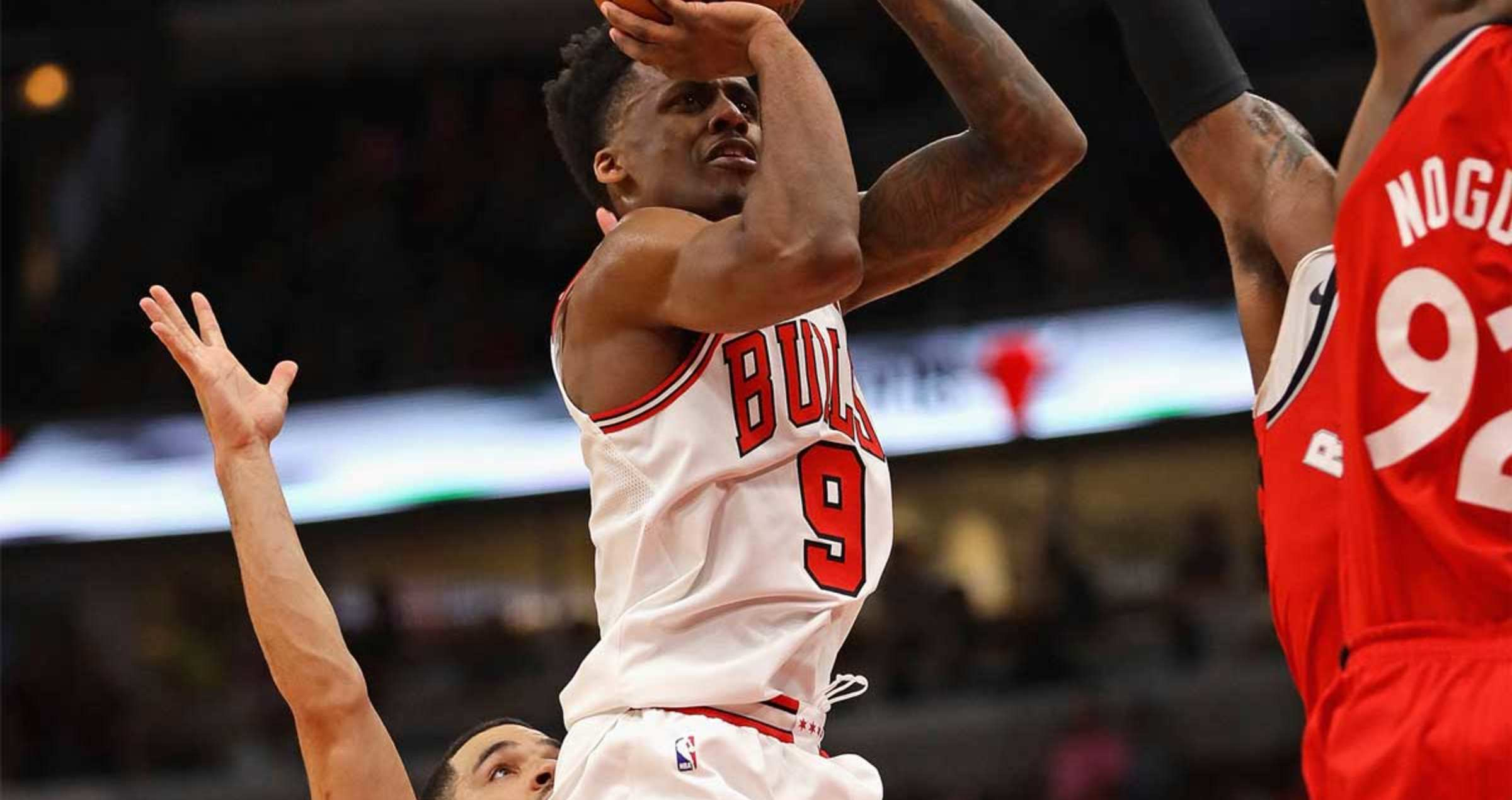 Antonio Blakeney #9 of the Chicago Bulls puts up a shot against Lucas Nogueira #92 of the Toronto Raptors during a preseason game at the United Center on October 13, 2017 in Chicago, Illinois.